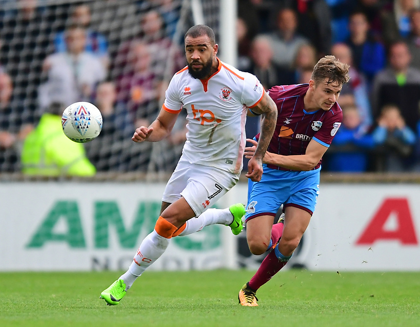 Blackpool's Kyle Vassell vies for possession with Scunthorpe United's Conor Townsend<br /> <br /> Photographer Chris Vaughan/CameraSport<br /> <br /> The EFL Sky Bet League One - Scunthorpe United v Blackpool - Saturday 9th September 2017 - Glanford Park - Scunthorpe<br /> <br /> World Copyright &copy; 2017 CameraSport. All rights reserved. 43 Linden Ave. Countesthorpe. Leicester. England. LE8 5PG - Tel: +44 (0) 116 277 4147 - admin@camerasport.com - www.camerasport.com