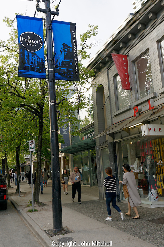People walking Robson Street, a popular  shopping district in downtown Vancouver, BC, Canada