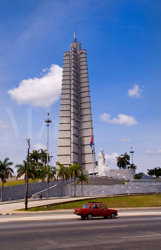 Havana capitol city of Cuba auto passing by the Revolution Square that celebrates the Fidel Castro takeover monument