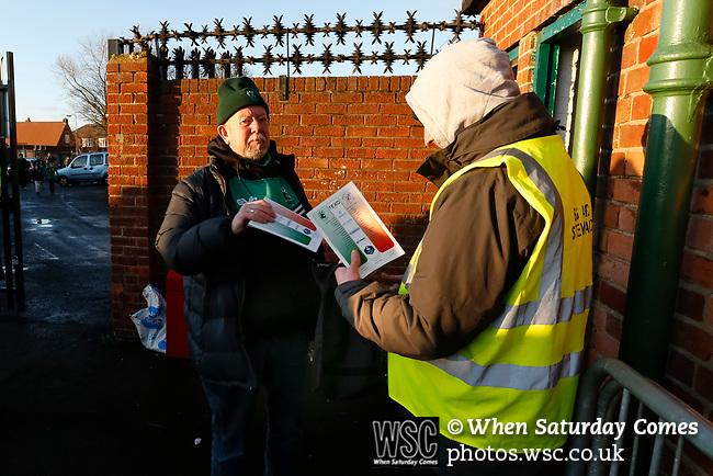 A Blyth fan buying a programme. Blyth Spartans v Brackley Town, 30112019. Croft Park, National League North. Photo by Paul Thompson.