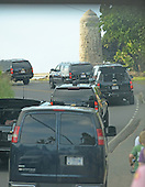 President Barack Obama's motorcade gets stuck near the Lanikai marker in some traffic while heading back from the Mid Pacific Country Club after 18 holes of golf.  January 1, 2014. photo Cory Lum<br /> Credit: Cory Lum / Pool via CNP