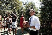 Washington, DC - April 27, 2009 -- United States President Barack Obama watches as members of the NCAA champion University of Connecticut women's basketball team shoot some baskets Monday, April 27, 2009, at the White House basketball court. President Obama earlier honored the team at a ceremony on the South Portico of the White House. .Credit: Pete Souza - White House via CNP