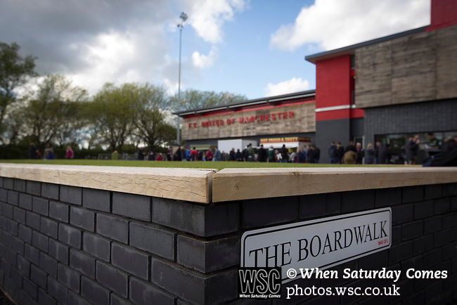 FC United of Manchester 0 Benfica 1, 29/05/2015. Broadhurst Park, Stadium Opening. Club signage on the main stand at Broadhurst Park, Manchester, the new home of FC United of Manchester, pictured before the club's match against Benfica, champions of Portugal, which marked the official opening of their new stadium. FC United Manchester were formed in 2005 by fans disillusioned by the takeover of Manchester United by the Glazer family from America. The club gained several promotions and played in National League North in the 2015-16 season, but lost this match 1-0. Photo by Colin McPherson.