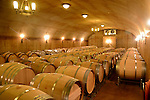 Barrels of wine age in a cellar at a California winery. (DOUG WOJCIK MEDIA)