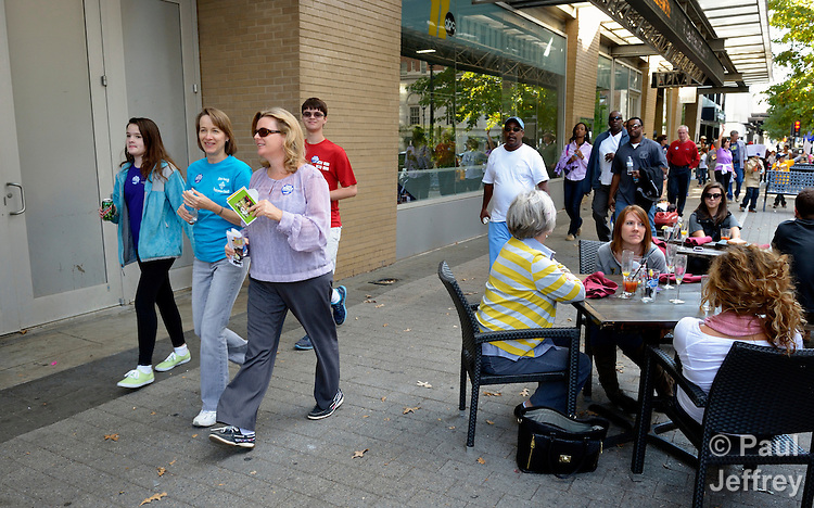 Participants walk along a downtown city sidewalk during the CROP Hunger Walk, held October 27, 2013, in Raleigh, North Carolina.