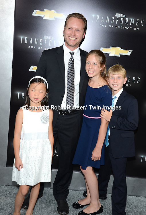 "Ehren Kruger and family attends the US Premiere of ""Transformers: Age of Extinction"" on June 25, 2014 at The Ziegfeld Theatre in New York City, New York, USA."