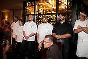 Chef Ryan Payne of Weathervane (center left) and Chef Adam Rose of Il Palio (center right) wait patiently with their teams as the final votes are announced in the semifinal round of the Fire In The Triangle dining series at 1705 Prime in Raleigh.