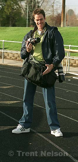 Keith Johnson, with his camera bag covering his crotch to protect himself while photographing pole vaulting.<br />