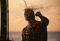 Big wave rider Ross Clarke Jones (AUS) under the shower after surfing big waves at Waimea Bay, North Shore Oahu, Hawaii. circa 1990. Photo: joliphotos.com
