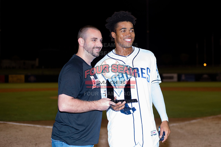 AFL West left fielder Buddy Reed (85), of the Peoria Javelinas and San Diego Padres organization, is presented with the MVP Award by Kevin Moodhe from Topps after the Fall Stars game at Surprise Stadium on November 3, 2018 in Surprise, Arizona. The AFL West defeated the AFL East 7-6 . (Zachary Lucy/Four Seam Images)