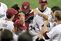 Starting pitcher Jordan Montgomery (34) of the South Carolina Gamecocks is congratulated by teammates after being pulled in the ninth inning in an NCAA Division I Baseball Regional Tournament game against the Campbell Camels on Friday, May 30, 2014, at Carolina Stadium in Columbia, South Carolina. South Carolina won, 5-2. (Tom Priddy/Four Seam Images)