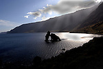 Roque de la Bonanza,back lit with shafts of sunlight. El Hierro, Canary Islands, Spain.