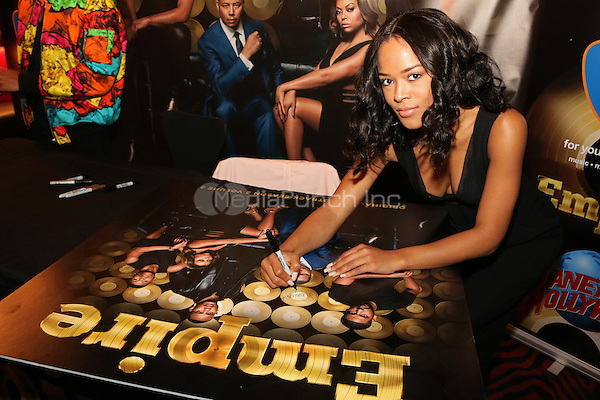 NEW YORK, NY - MAY 14, 2016 Serayah signs autographs at the Empire Season 2 release cd signing at Planet Hollywood, May 14, 2016. Photo Credit: Jamel Johnson / Media Punch