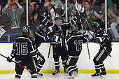Brad Bogus, (center) celebrates with teammates and fans after scoring a second period goal during hockey action against Clarkston at the Detroit Skate Club Thursday, March 1, 2012.