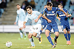 Getafe's Stefan Scepovic (r) and Celta de Vigo's Jonny Castro during La Liga match. February 27,2016. (ALTERPHOTOS/Acero)