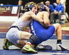 Chase Liardi of Massapequa, left, battles Andrew Gaudiuso of Port Washington at 99 pounds during the Nassau County Divsision I varsity wrestling quarterfinals at Hofstra University on Saturday, Feb. 11, 2017. Liardi won the match by major decision 8-0.