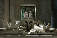Feet of the effigies from the tomb of Henri II, 1519–59, and Catherine de Medici, 1519–89, in the Basilique Saint-Denis, Paris, France. The funerary monument was made 1560-73 by Francesco Primaticcio, Jacquio Ponce and Germain Pilon but the original effigies were rejected by Catherine de Medici and new more natural sculptures were made. Behind, are the seated figures from the funerary monument of Louis XII, 1462-1515, and Anne of Brittany, 1477-1514, made 1516-31 in Carrara marble by Giovani di Giusto Betti, 1479-1519. The basilica is a large medieval 12th century Gothic abbey church and burial site of French kings from 10th - 18th centuries. Picture by Manuel Cohen