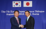 Taro Aso and Yoo Il-ho, Aug 27, 2016 : Japanese Finance Minister Taro Aso (R) meets his South Korean counterpart Yoo Il-ho at an office of the South Korean Government Complex Seoul in Seoul, South Korea. The bilateral meeting is the seventh talks between Japan and South Korea since 2006. The finance ministers from Japan and South Korea will discuss ways to enhance policy coordination and to make concerted efforts to stabilize the Asian financial market, local media reported. (Photo by Lee Jae-Won/AFLO) (SOUTH KOREA)