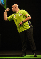 21.05.2015. London, England. Betway Premier League Darts Play-Offs.   Michael van Gerwen [NED] in action during the final against Gary Anderson [SCO].  Betway Premier League final at The O2 in London on Thursday May 21.