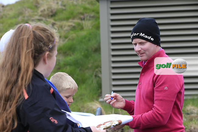 Richard McEvoy (ENG) signs autographs for fans after his round during Saturday's Round 3 of the 2015 Dubai Duty Free Irish Open, Royal County Down Golf Club, Newcastle Co Down, Northern Ireland 5/30/2015<br /> Picture Eoin Clarke, www.golffile.ie