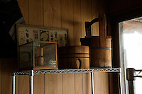 Wooden buckets on the shelf at Eifu Kawamata's Okeei atelier.