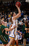 BROOKINGS, SD - FEBRUARY 6:  Tiffaney Flaata #35 from South Dakota State lays the ball up past a trio of defenders from North Dakota State Saturday afternoon at Frost Arena in Brookings. (Photo by Dave Eggen/Inertia)