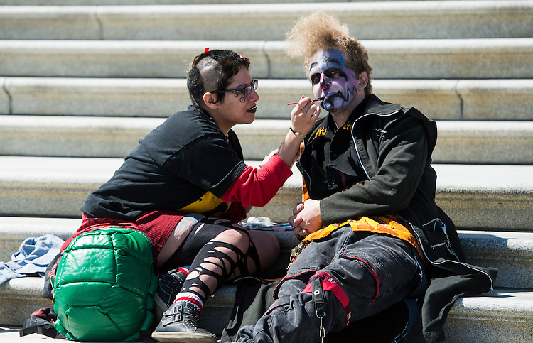 UNITED STATES - MARCH 31: Turtle Addams, left, touches up the face paint on Jonathan Jensen on the steps to the Senate at the U.S. Capitol on Monday, March 31, 2014. The two Ringling Bros and Barnum & Bailey Circus workers took advantage of a rare day off to take in the Capitol before heading to the WWE Monday Night Raw wrestling event at Verizon Center Monday night. (Photo By Bill Clark/CQ Roll Call)