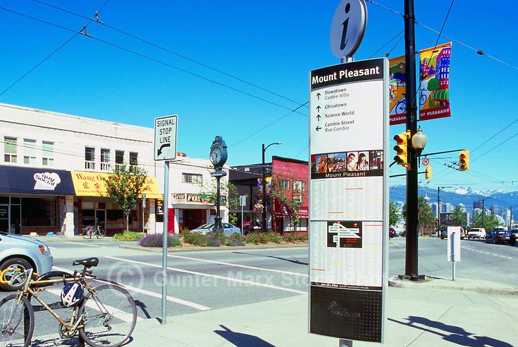 Vancouver, BC, British Columbia, Canada - Main Street Scene, Shops and Restaurants in Mount Pleasant Neighbourhood (Mt Pleasant Clock in midground)