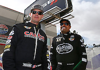Mar 30, 2014; Las Vegas, NV, USA; NHRA top fuel driver Steve Torrence (left) with Khalid Albalooshi during the Summitracing.com Nationals at The Strip at Las Vegas Motor Speedway. Mandatory Credit: Mark J. Rebilas-