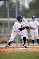 Western Connecticut Colonials left fielder Tre' Gause (25) squares to bunt during the first game of a doubleheader against the Edgewood College Eagles on March 13, 2017 at the Lee County Player Development Complex in Fort Myers, Florida.  Edgewood defeated Western Connecticut 3-0.  (Mike Janes/Four Seam Images)