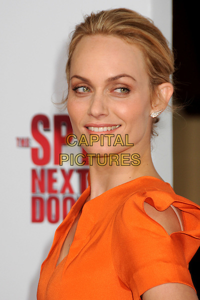 "AMBER VALLETTA.""The Spy Next Door"" Los Angeles Premiere held at The Grove,  Los Angeles, California, USA, .9th January 2010..portrait headshot  hair up orange smiling .CAP/ADM/BP.©Byron Purvis/Admedia/Capital Pictures"