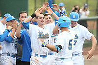 Ryan Kreidler (3) of the of UCLA Bruins welcomes back teammate Sean Bouchard (5) to the dugout during a game against the University of San Diego Toreros at Jackie Robinson Stadium on March 4, 2017 in Los Angeles, California.  USD defeated UCLA, 3-1. (Larry Goren/Four Seam Images)