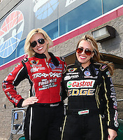 Mar 30, 2014; Las Vegas, NV, USA; NHRA top fuel driver Brittany Force (right) poses with her sister, funny car driver Courtney Force during the Summitracing.com Nationals at The Strip at Las Vegas Motor Speedway. Mandatory Credit: Mark J. Rebilas-