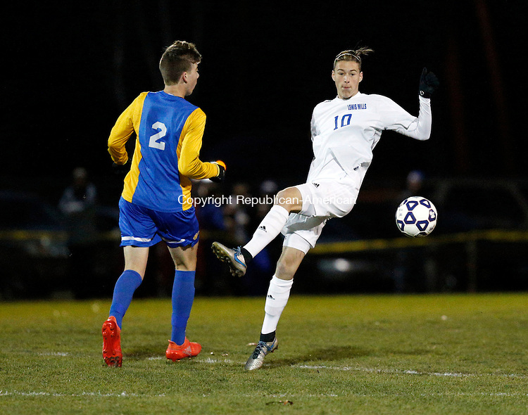 Burlington, CT- 12 November 2016-111216CM07-  Lewis Mills' Peter Christiano right,  attempts to control the ball against Brookfield's Simon Gardner  during their state tournament matchup on Saturday.     Christopher Massa Republican-American