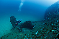 TX2122-D. A scuba diver (model released) swims between the huge blades of the propeller of the SS Perseus. This 445-foot-long steamship sank in 1917 during World War I, a casualty of a sea mine laid by the infamous SMS Wolf, a German armed commercial raiding ship which harried Sri Lanka waters and abroad, sinking dozens of vessels. This historic wreck rests in the sand 130 feet deep and is one of the premier dive sites and artificial reefs in Sri Lanka. Sri Lanka, Indian Ocean.<br /> Photo Copyright © Brandon Cole. All rights reserved worldwide.  www.brandoncole.com