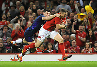 Wales' George North charges past the attempted tackle by Scotland's Blair Kinghorn<br /> <br /> Photographer Ian Cook/CameraSport<br /> <br /> Under Armour Series Autumn Internationals - Wales v Scotland - Saturday 3rd November 2018 - Principality Stadium - Cardiff<br /> <br /> World Copyright &copy; 2018 CameraSport. All rights reserved. 43 Linden Ave. Countesthorpe. Leicester. England. LE8 5PG - Tel: +44 (0) 116 277 4147 - admin@camerasport.com - www.camerasport.com