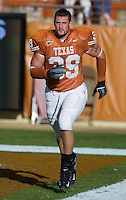 30 September 2006: Texas defensive end Brian Robison, who injured his leg during last week's game, warms up prior to the Longhorns 56-3 victory over the Sam Houston State Bearkats at Darrell K Royal Memorial Stadium in Austin, TX.