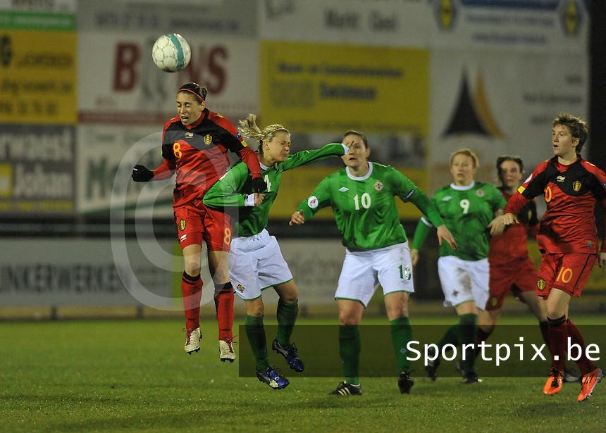 UEFA Women's Euro Qualifying group stage (Group 3) -  KFC Dessel - Armand Melis Stadion : BELGIUM -Northern Ireland ( Belgie - Noord Ierland ) : Audrey Demoustier wint het duel van Nadene Caldwell..foto DAVID CATRY / Vrouwenteam.be / Loft6.be