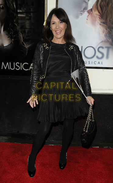 "ARLENE PHILLIPS.""Ghost The Musical"" press night, Piccadilly Theatre, Denman St., London, England..July 19th, 2011.full length black dress leather jacket tights mouth open smiling.CAP/CAN.©Can Nguyen/Capital Pictures."
