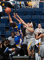 Mikayla Lyles of California tries to block the ball during the game against Bakersfield at Haas Pavilion in Berkeley, California on December 15th, 2013.  California defeated Bakersfield Roadrunners, 70-51.