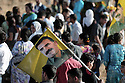 Iraq 2009.Supporters of PKK near the Turkish border with the portrait of Abdullah Ocalan on a flag.Irak 2009.Sympathisants du PKK pres de la frontiere turque avec un portrait d'Abdullah Ocalan sur un drapeau.