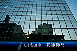 Buildings are reflected from a Citibank branch in New York. 16/10/2012. The Board of Directors of Citigroup announced that Vikram Pandit has stepped down as the Company's CEO and it has unanimously elected Michael Corbat as new CEO and a director of the Board. Photo by Eduardo Munoz Alvarez / VIEWpress.