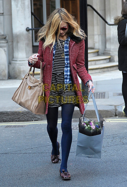FEARNE COTTON.Leaving BBC Radio 1, London, England, UK, January 31st 2011..full length red fur collar tweed wool coat navy white striped dress plaid shirt ribbed tights loafers burgundy maroon beige bag tote flowers bouquet round frame sunglasses Warehouse French Connection high street fashion looking head down .CAP/DYL.©Dylan/Capital Pictures.