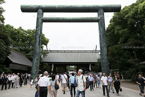 People visit Yasukuni Shrine to pay their respects to the war dead on the 71st anniversary of Japan's surrender in World War II on August 15, 2016, Tokyo, Japan. Some 70 lawmakers visited the Shrine to pay their respects, but the Prime Minister Shinzo Abe did not visit the controversial symbol and instead sent a ritual offering to a shrine. Yasukuni enshrines the war dead including war criminals and as such visits by Japanese  politicians tend to provoke anger from neighbors China and Korea that suffered from Japan's militarist past. (Photo by Rodrigo Reyes Marin/AFLO)