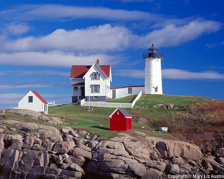 "York County; ME<br /> Cape Neddick (""Nubble"") Light Station (1879) under scattered clouds"