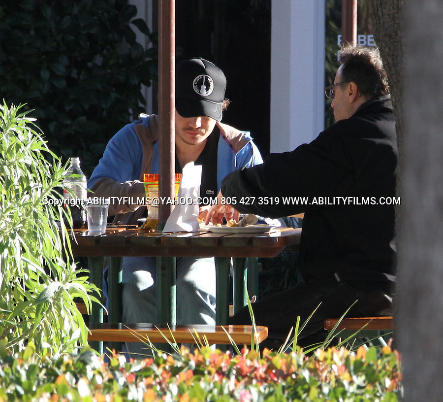 JANUARY 16TH 2013   Exclusive ....Emile Hirsch wearing a Eddie Vedder guitar tour hat eating lunch with his dad in Malibu California & Brody Jenner  also eating in the background wearing all black. Emile was carrying his coke and corn nuts to go . ....ABILITYFILMS@YAHOO.COM..805 427 3519..WWW.ABILITYFILMS.COM