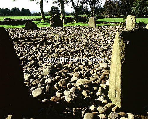 Templewood Stone Circle and Cist, Kilmartin, Argyll and Bute, Strathclyde, Scotland. Celtic Britain published by Orion. A perfect stone circle comprises of  thirteen stones, 13 metres in diamater at its centre is a small slab cist surrounded by a further ring of small stones, this is the burial place of a small child.