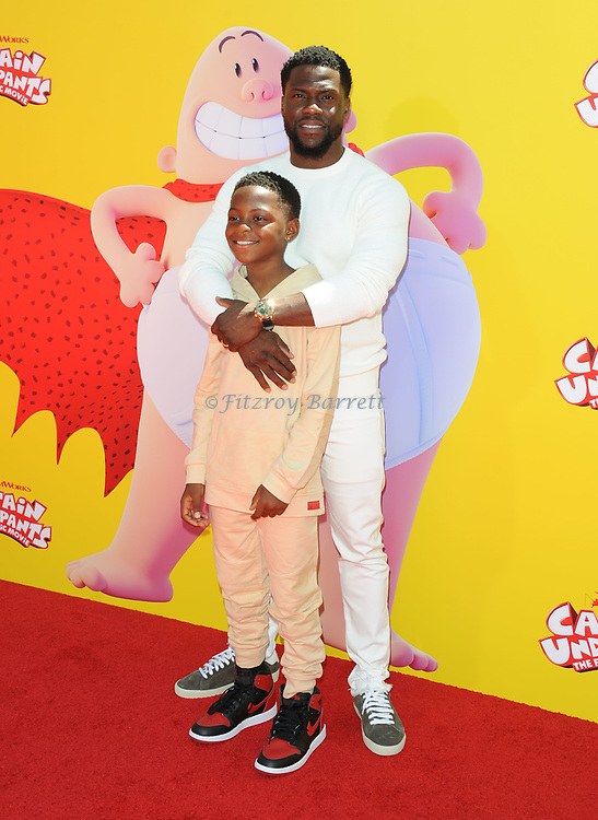Kevin Hart and son arriving at the Los Angeles premiere of Captain Underpants, held at the Regency Village Theater in Westwood California on May 21, 2017