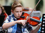 Spencer Bray, 13, performs in the Carson City Symphony's Youth Strings Summer Program concert in Carson City, Nev., on Thursday, July 27, 2017. <br />