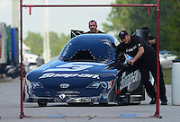 Jan. 16, 2013; Jupiter, FL, USA: Crew members push the car of NHRA funny car driver Cruz Pedregon through tech inspection during testing at the PRO Winter Warmup at Palm Beach International Raceway.  Mandatory Credit: Mark J. Rebilas-